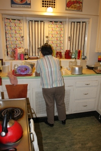 My grandmother washing our dishes!