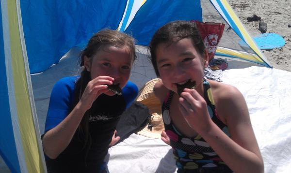 Kristina's daughter and Daja's daughter eating seaweed (not the kind that washed up on the shore) on the beach.