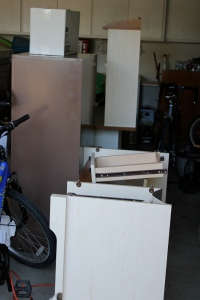 The file cabinet and broken down bottom half of the new desk.