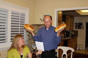 Kristina's husband, Jordan, blessing the Challah before the feast!